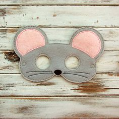 With this mouse mask, your little one can creep around the house looking like a tiny mouse, but can he or she be as quiet as one? Thats doubtful! Youre sure to be in store for giggles aplenty when your kiddo is dressed up in this gray, pink and black handmade felt mask. Kids mask is