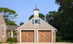 Interesting Large Garage Plans For The Big House: Stunning Detached Garage And Shed Design Large Garage Plans With Wooden Door At The Traditional House Surrounded By Lush Vegetations ~ SFXit Design Exterior Inspiration Wooden Garage Doors, Garage Door Design, Barn Doors, Garages, Shed Design, House Design, Garage Door Makeover, Exterior Makeover, Garage Addition