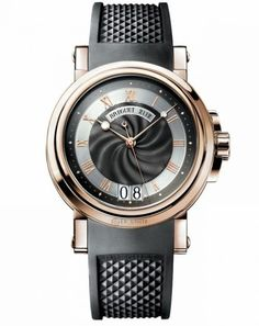 Breguet Marine 5817BR/Z2/5V8.Marine wristwatch in 18-carat pink gold. Self-winding movement. Black rhodium-plated 18-carat gold dial with wave pattern hand-engraved on a rose engine.Chapter ring with Roman numerals and luminous dots. Large date calendar at 6 o'clock. Engine-turned caseback with sapphire crystal. Screw-locked crown. Rubber strap with folding clasp. Also available with pink gold bracelet.