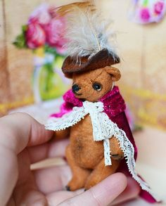 Hello! This is my new OOAK bear Christopher . I sewed him from the vintage viscose. He is 7.5 cm high. He is stuffed firmly with sawdust and metal pellets. He toned oil paints. He is fully jointed, 5 way jointed. Bear has black glass eyes. Bear can move his arms, legs and head.