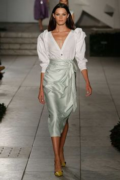 Wrap around metallic pencil skirt with a white shirt tucked in - the outfit also features standout sleeves - Carolina Herrera Spring 2018 #ladylike...x