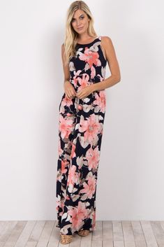 6987aeeae8d A floral print maxi dress. Sleeveless. Front pockets. Rounded neckline.  This style