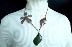 """This gemstone necklace is created by hand from pure copper sheet, wire and natural gemstones. I have combined a number of techniques to bring this design to life, and enjoyed every second of sawing, hammering, filing, soldering and wrapping in delicate wire. The flower measures 3"""" x 2.5"""" (7.5cm x..."""