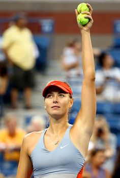 Maria Sharapova Photos: US Open: Day 3. Maria Sharapova of Russia celebrates defeating Alexandra Dulgheru of Romania after their women's singles second round match on Day Three of the 2014 US Open at the USTA Billie Jean King National Tennis Center on August 27, 2014 in the Flushing neighborhood of the Queens borough of New York City.