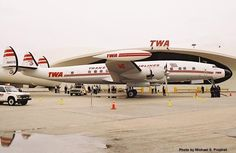L1049 Constellation  TWA  At Idlewild Airport -- Saarinen roofline echoes the beautiful curves of the aircraft. So beautiful!