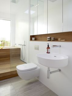 The Shima Scuro features on the floor combined with wood finishes creates a fantastic modern yet warm bathroom.