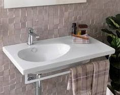 Sink with side countertop