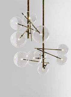 Bolle, hanging lamp. Metal parts in hand burnished brass. Designed by Massimo Castagna for Gallotti
