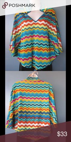 Amazing Cover Cape W/Chevron Printed Fabric Almost New. This cape is really cute and adorable. Soft and comfy. Hard to find. Gorgeous colors and exclusive combination. One Size. Negotiable Price. Jackets & Coats Capes