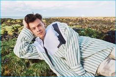 Harry Styles relaxes in an oversized stripe shirt from Raf Simons' spring-summer 2017 collection.