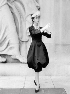 1959 Odile in silk-satin dress poufed out over slim skirt by Yves Saint Laurent for Dior, photo by Willy Maywald, Paris