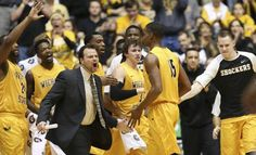 The Wichita State bench cheer for Anton Grady against New Mexico State at Koch Arena. (February 15, 2016)