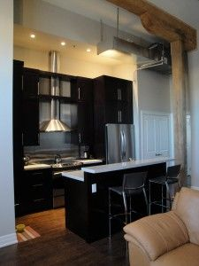 Loft kitchen in the beautiful historic building by the Grand River, Cambridge Ontario Cambridge Ontario, Loft Kitchen, Lofts, Beautiful, House Styles, Building, Table, Kitchens, Design