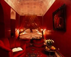From what I have red about Gothic interior decorating (aside from an abundance of black) Royal and Blood red is a favourite colour. I think this room is REALLY awesome. What do you think?