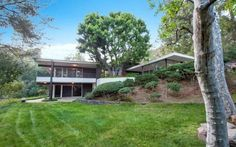 This Asian-influenced mid-century modern residence, designed by architect Richard Stoddard for the Hollander family, is now on the market for the first time since it was built in 1964. The spacious 4,972 square foot home is situated up a long private driveway and features an open floor plan with floor-to-ceiling windows.