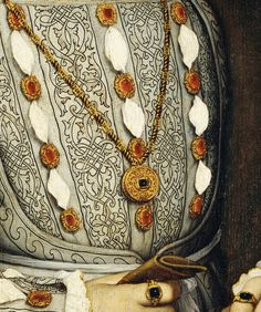 Hans Holbein the Younger. Detail from Portrait of Henry VIII of England, 1536. The King's suite of dress jewels is doubtless accurately depicted by Holbein. The stones are probably 'balas' rubies, ie spinels,( the stones lack the bright tone associated with rubies proper) very likely foiled at the back to intensify their colour. Queen Elizabeth wore these dress jewels frequently.