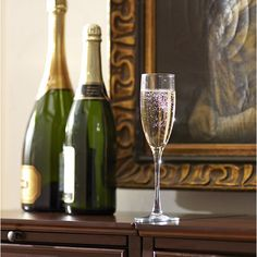Sparkling Wine Flutes | Tall and shapely, these stemmed glass flutes are ideal for serving bubbly vintages. Set of four.