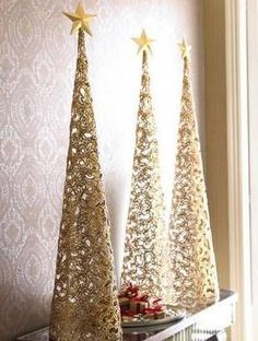 Mod podge old lace over styrofoam cone, let it dry. Remove from cone and spray paint gold or silver. Fill with white lights and embellish with a star. Make different sizes for an awesome grouping!