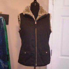 Reversible faux fur vest from Gap Black faux fur vest. 2 front pockets, dry clean only. GAP Jackets & Coats Vests