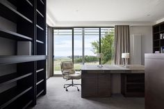 Study positioned to overlook the rural surrounds. A large two person desk custom designed by B.E Architecture with inset leather detail.