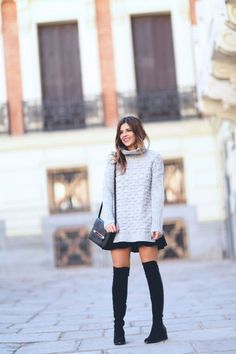 For a cute and casual look, try wearing a pale knit sweater over a mini dress, all paired with black over the knee boots. Via Natalia Cabezas. Sweater: Asos, Skirt: Zara, Boots: Unisa, Bag: LK Bennet.
