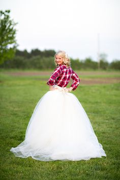 Love this bride in plaid shirt for country wedding theme. -- his flannel, of course