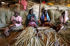 Displaced sudanese women weaving baskets. Available for purchase.