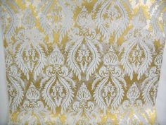 2 Vintage Wallpaper Rolls  This vintage wallpaper has an elaborate white flocked design on a gold and silver mottled background. The…