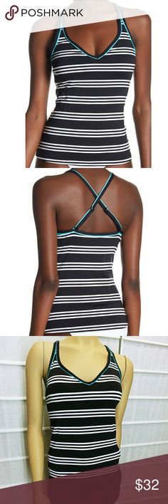 Jag Crisscross Stripped Tankini Top Jag Crisscross Stripped Tankini Top, size XS, color black and white,  crisscross back, V-neck, Adjustable crisscross straps, Allover print, Contrast trim, Padded, Shelf bra lining, made of 92% polyester, 8% elastane Trim: 84% polyamide, 16% elastane Lining: 100% polyester,  compare $78.00 retail value, comes new with tag as store job-out merchandise in good condition. jag Swim