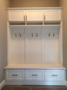 Here are some mudroom lockers with coat hooks and drawers below and cabinets above for lots of storage.