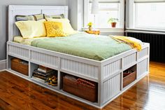 Set aside a few hours for some weekend building and you could have this pretty beadboard bed (and 23 extra cubic feet of storage) by Monday morning.