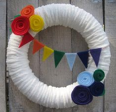 DIY Tutorial from A Catch My Party Member – How to Make a Rainbow Wreath « The Catch My Party Blog