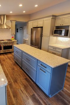 A narrow island provides plenty of storage while maintaining the spacious feel of this Willow Gray kitchen. Discount Cabinets, Gray Cabinets, Diy Kitchen Remodel, Wood Floor, Cabinet Doors, Family Life, Home Improvement, Kitchens, Sweet Home