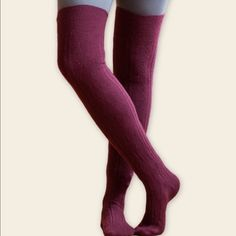 """Merino Wool Thigh Highs, Wine These gorgeous, super soft thigh highs are made in the USA from locally sourced organic wool.  Pretty cable knit pattern, 69% merino wool, 29% nylon, 2% spandex.  Maggie's Organics calls these """"over the knee"""" But they go to mid thigh (I'm 5'4"""").  This listing is for the wine color - I do have a pair of slate blue, so comment if you are interested.  Happy Poshing! Maggies Organics Accessories Hosiery & Socks"""