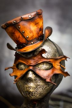 Sculpted Leather Mask and Hat by Kenn Osborne :  Extremely impressive quality and craftsmanship. All the details and finishing touches are just amazing! Perfect blending of the colors. Very well made.  Inspires me to always reach for perfection.