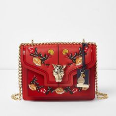 River Island Red embroidered jaguar lock chain satchel bag (3.790 RUB) ❤ liked on Polyvore featuring bags, handbags, vegan handbags, chain purse, red purse, chain strap handbag and faux-leather handbags