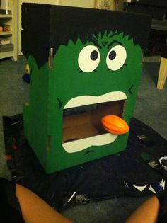 Hulk game for Avengers birthday party. I made this with a box I had & some paint.