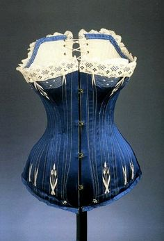 Corset in blue silk, circa 1890. Is this the way to keep a skinny waist or was it just torture?