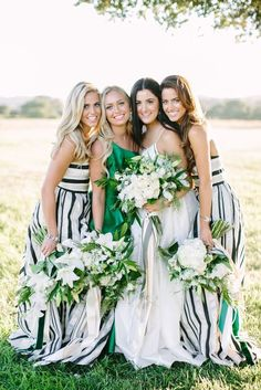 These black and white striped bridesmaid dresses are so unique for a modern wedding! The striped ribbon for the bridal bouquet matches and the green maid of honor dress adds a stylish pop of color.