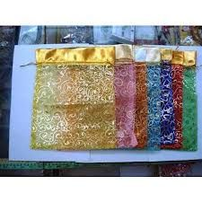 Organza bags in bright colors for party favors, even a few Ferraro Roche chocolates would look Indian inside them