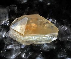 3.5 Gmelinite (Hydrated Sodium Calcium Aluminum Silicate) - Gmelinite-Na on analcime. Avdhellero, Larnaka, Cyprus. Image width, 5mm.  © Volker Betz. - Crystallography:     Unit cell: gmelinite-Ca   a  13.800, c 9.964 Å  (Galli et al. 1982) gmelinite-K   a  13.621, c 10.254 Å  (Vezzalini et al. 1990) gmelinite-Na   a  13.756, c 10.048 Å  (Galli et al. 1982)   Space group: P63/mmc,  Z = 1