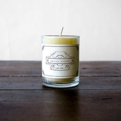"""erica tanov's signature beeswax votive candle in a heavenly lavender scent. made in usa. 100% beeswax with a cotton wick. 3 oz. burns for 24 hours. 2.5"""" x 2""""."""