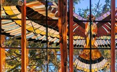Artist Neile Cooper built this dreamy stained Glass Cabin in the middle of the woods. The Glass Cabin is made almost entirely from repurposed window frames and lumber. Window Greenhouse, Glass Cabin, Cabin Design, Window Frames, Building Materials, Hearth, Bird Houses, Stained Glass, Fair Grounds