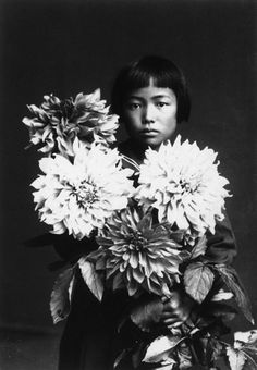 portrait of Yayoi Kusama. (proof that our obsession with giant flowers is nothing new.)