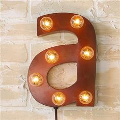 "Vintage Style Sign Letters Sconce...so fun  ""art"" or ""play"" or ""read"" or ""teach""    ""play"" right over the piano below the pictures would look mag worthy!  but this may be my own silliness and not your thing!"