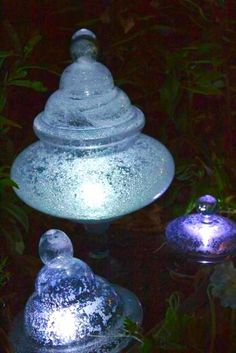 Create beautiful garden lights with a few household items and old decorative glass jars and lids!