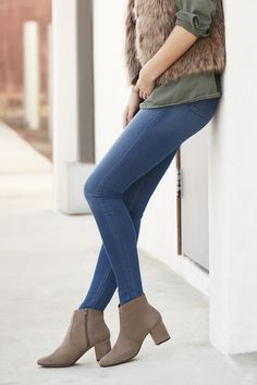 Suede booties with an almond toe, western-inspired stitching details, and a covered block heel.