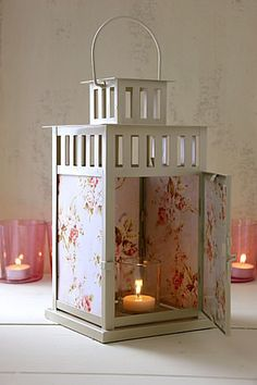 Ikea Lanterns. Versatile decor  that can be added to fit any style. With paint and scrapbook paper and even stain glass, the possibilities are endless. Shabby chic here for the country home.
