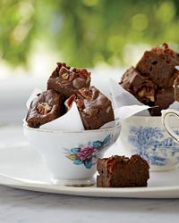 Bacon-Bourbon Brownies with Pecans | Kat Kinsman tops her rich brownies with bacon and pecans. To enhance the smoky flavor, she mixes some of the bacon fat into the batter.