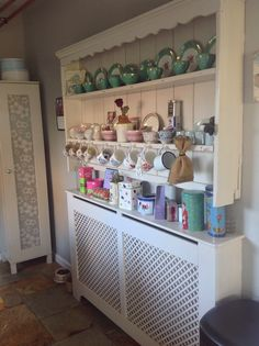 Make a dresser from reclaimed shelves and a radiator cover.